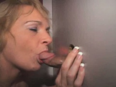 Blonde Takes Cumshot On Tits Through Glory Hole